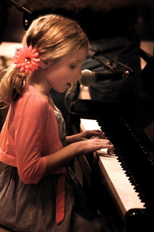 RCC child playing piano